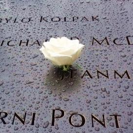 cropped-worldtradecenter-memorial-whiterose-w-names-watermarked-8-7-17