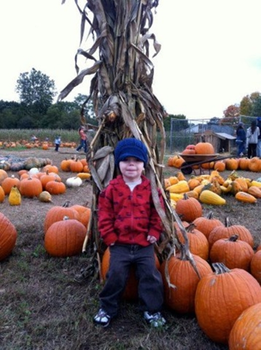 Zachary in hat.PumpkinPicking